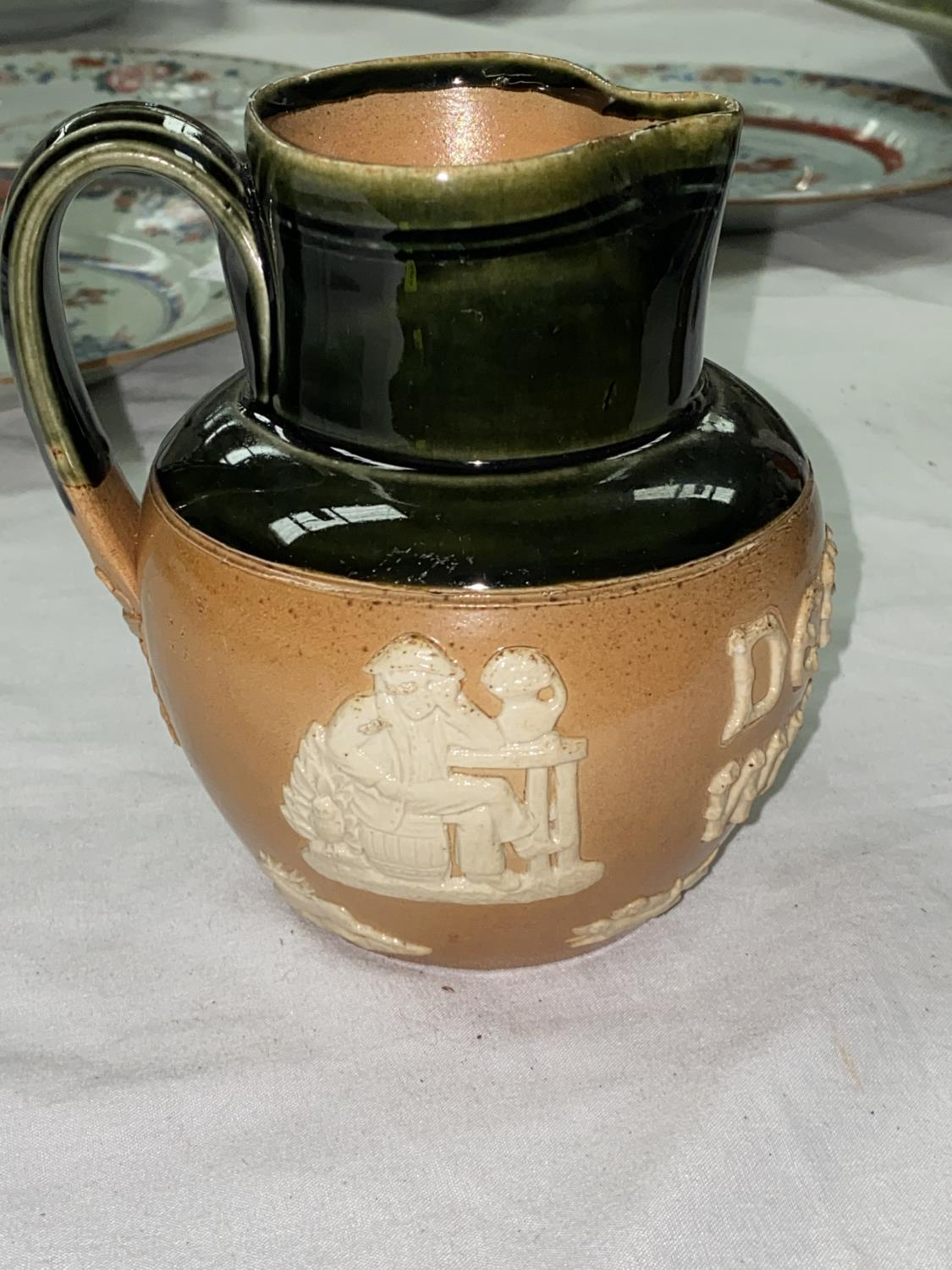 A DEWAR'S WHISKY Doulton stoneware advertising jug, 13cm (small chip to rim) - Image 3 of 5