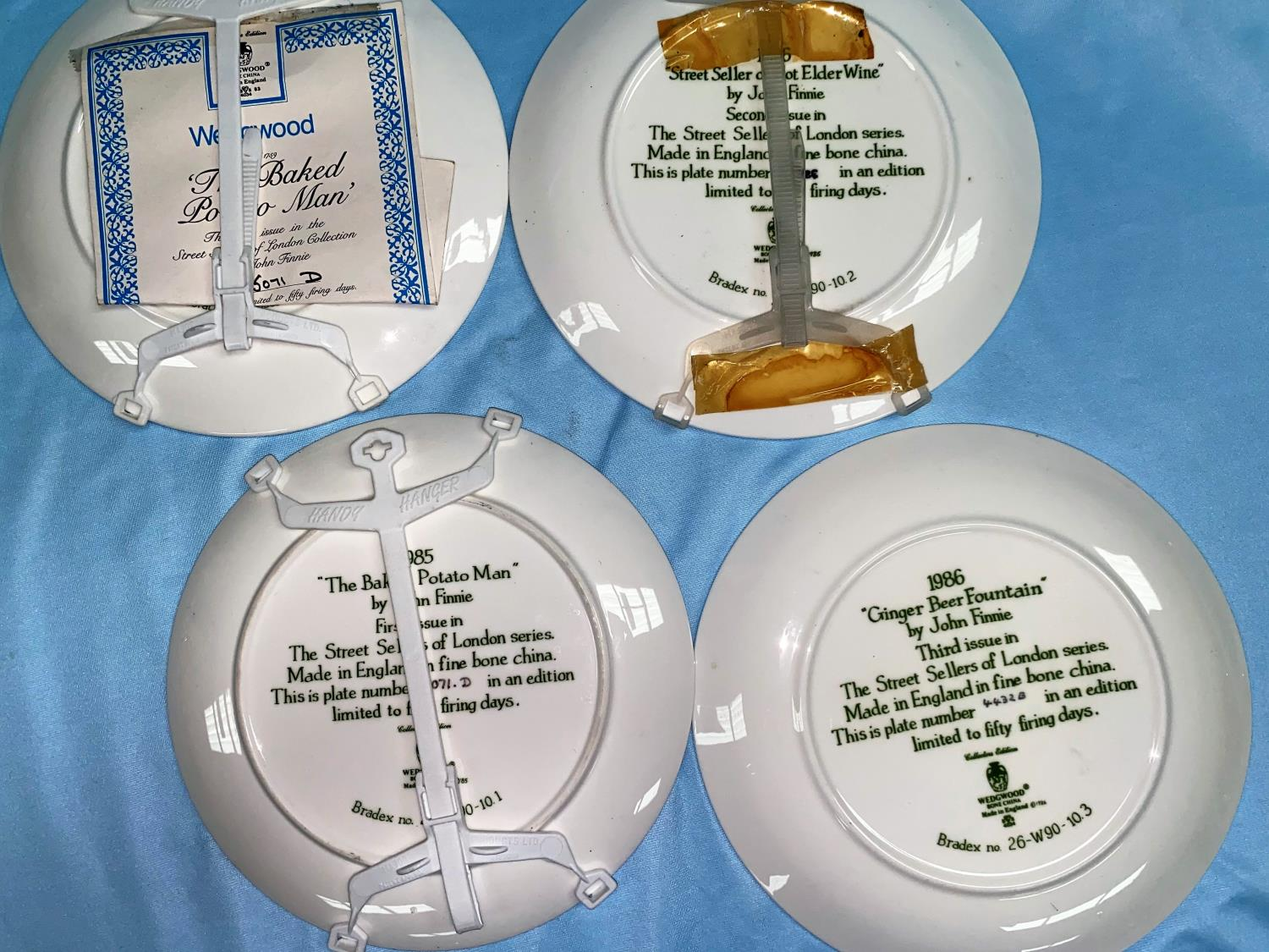 A Wedgwood set of 11 plates: Street Sellers of London; 2 others; a cut glass ship's decanter; a - Image 2 of 2