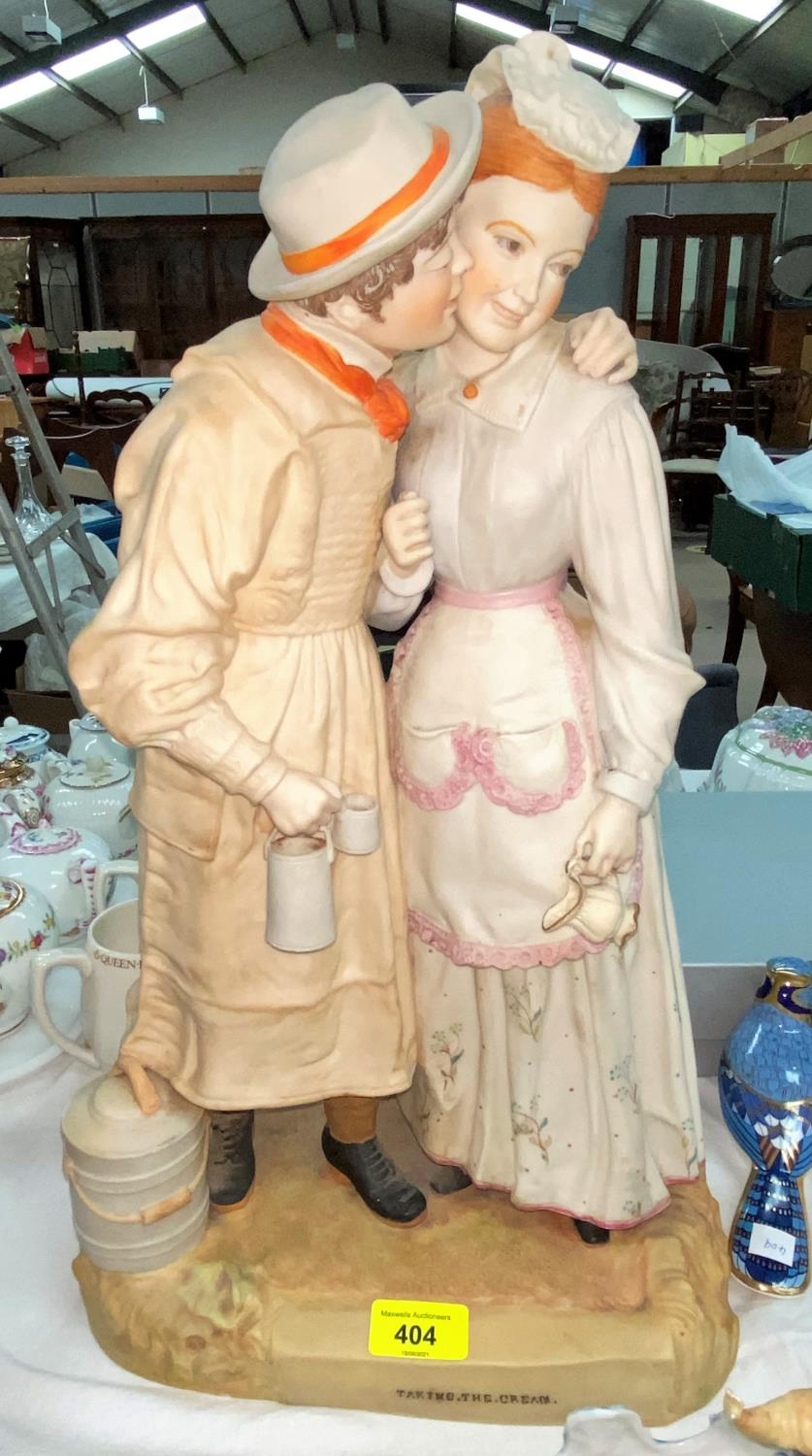 """A coloured bisque group in the Victorian style """"Taking the Cream"""", height 48 cm (restored)"""