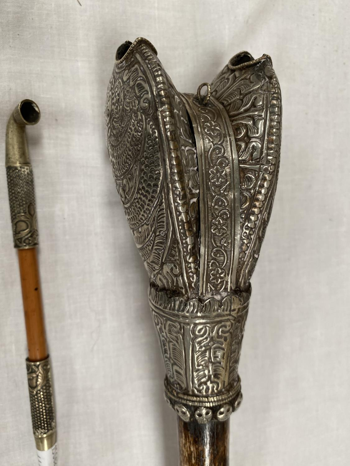 A Tibetan white metal mounted pipe with bone middle section, with dragon decoration; a Tibetan small - Image 3 of 4