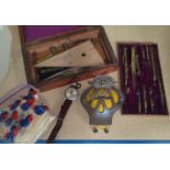 A 19th century geometry set in a mahogany box; a vintage motor car AA badge; a selection of Kensitas