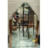 A tall Art Deco mirror made up of tile mirror squares in the central section, with peach colour