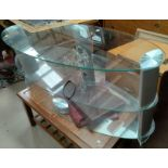 A glass 3-tier TV stand