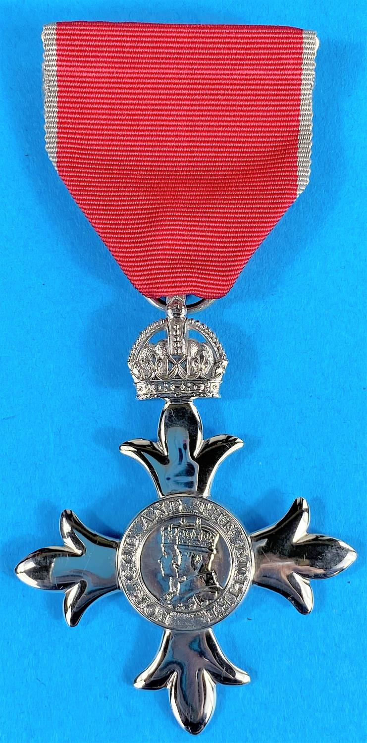 An M.B.E awarded in 1979 to Leslie Middleton Duxes with a folder of contemporary documents