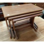 A mid 20th century nest of three occasional tables