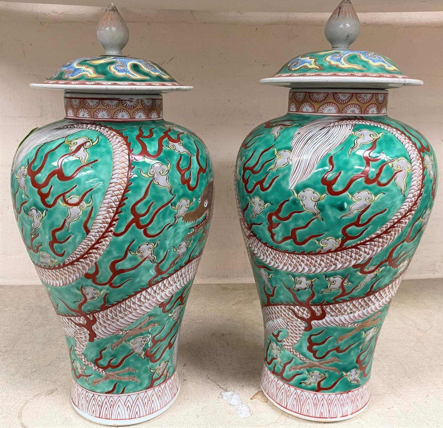A pair of Chinese green ground lidded baluster vases with dragon decoration lids bearing marks, - Image 2 of 11