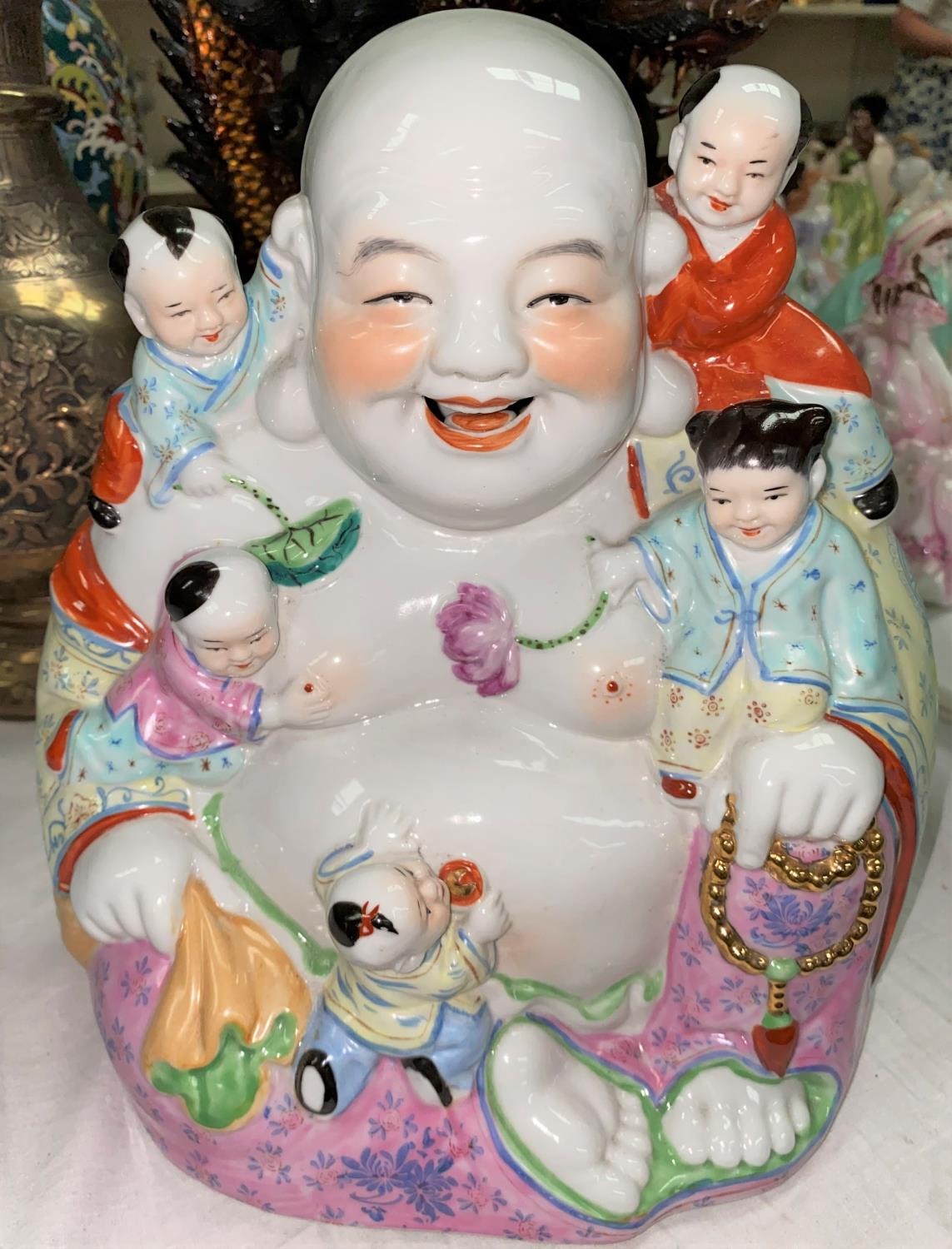 A Chinese figure of seated Hoti with children playing on him, height 28cm