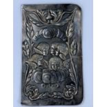 A 1920's hallmarked silver book cover embossed with cherubs, 12 x 7cm