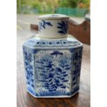 A Chinese blue and white canted squared lidded tea caddy with floral decoration, height 12cm