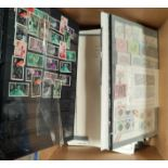 A selection of Commonwealth stamps on leaves etc