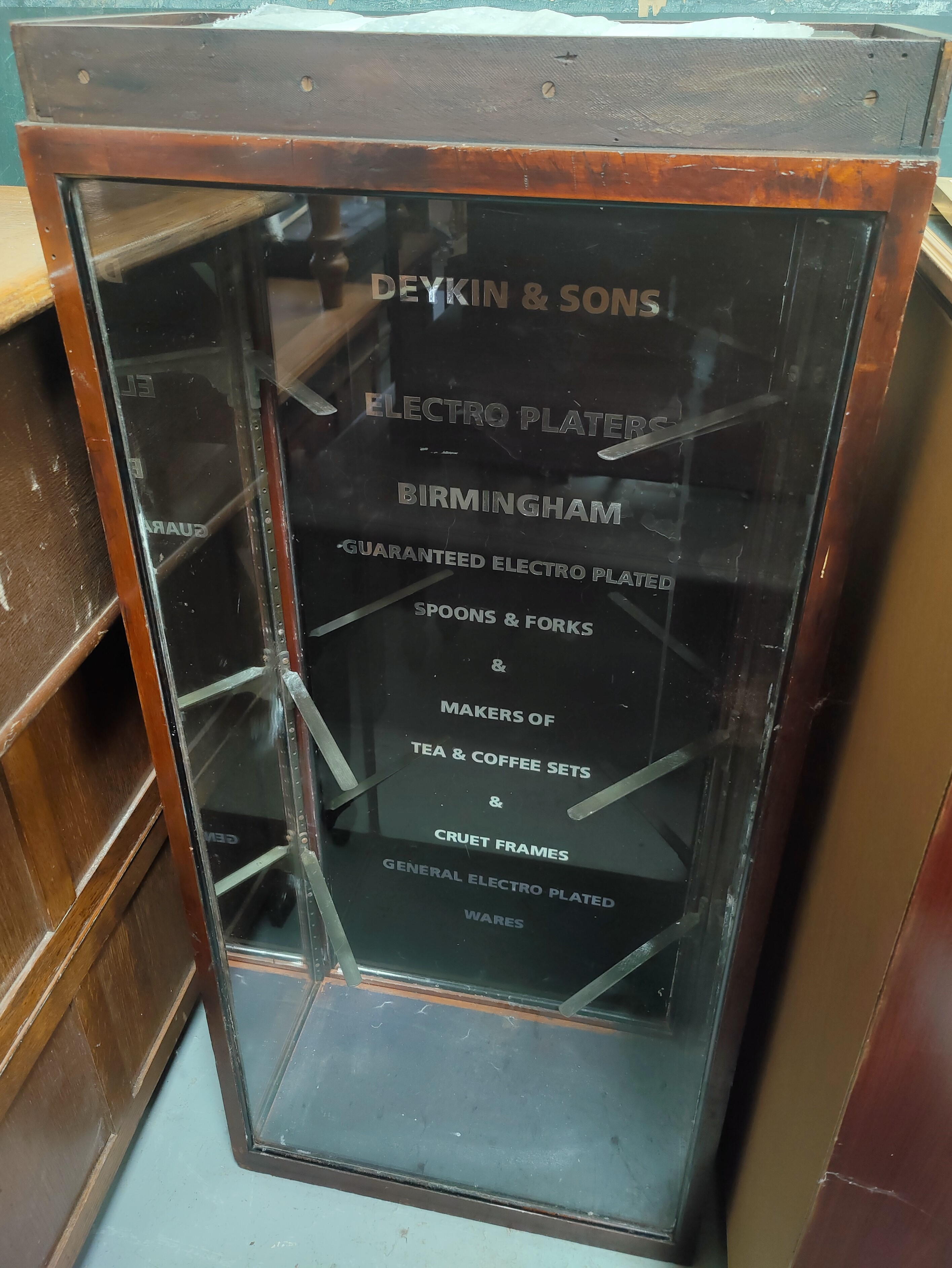 A Victorian / Edwardian shop display cabinet for a Birmingham cutlery factory, rear opening door and