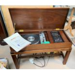 A Dynatron vintage stereogram in reproduction mahogany case, comprising 'gun box' brass mounted