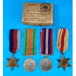 A WWII group of 4 medals including The African Star with medal slip in box to Lieutenant R.T.Jackson
