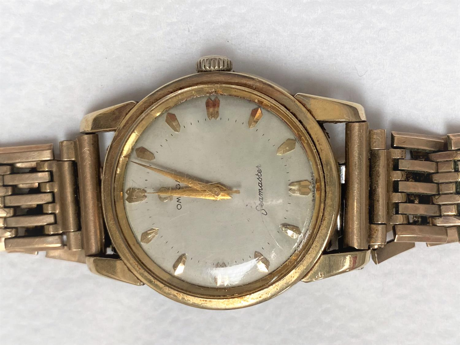 A vintage Omega Seamaster 17 jewel wristwatch with baton numerals and center seconds hand, no