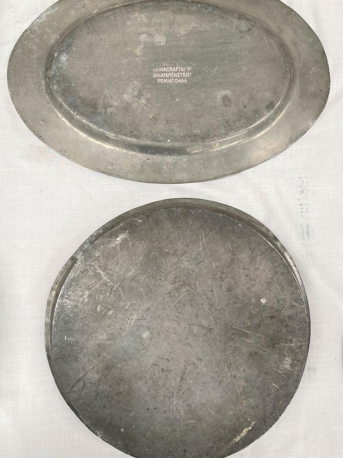 Two 20th century Chinese pewter trays - circular one with dragons, oval with mythical bird, 34cm x - Image 2 of 2