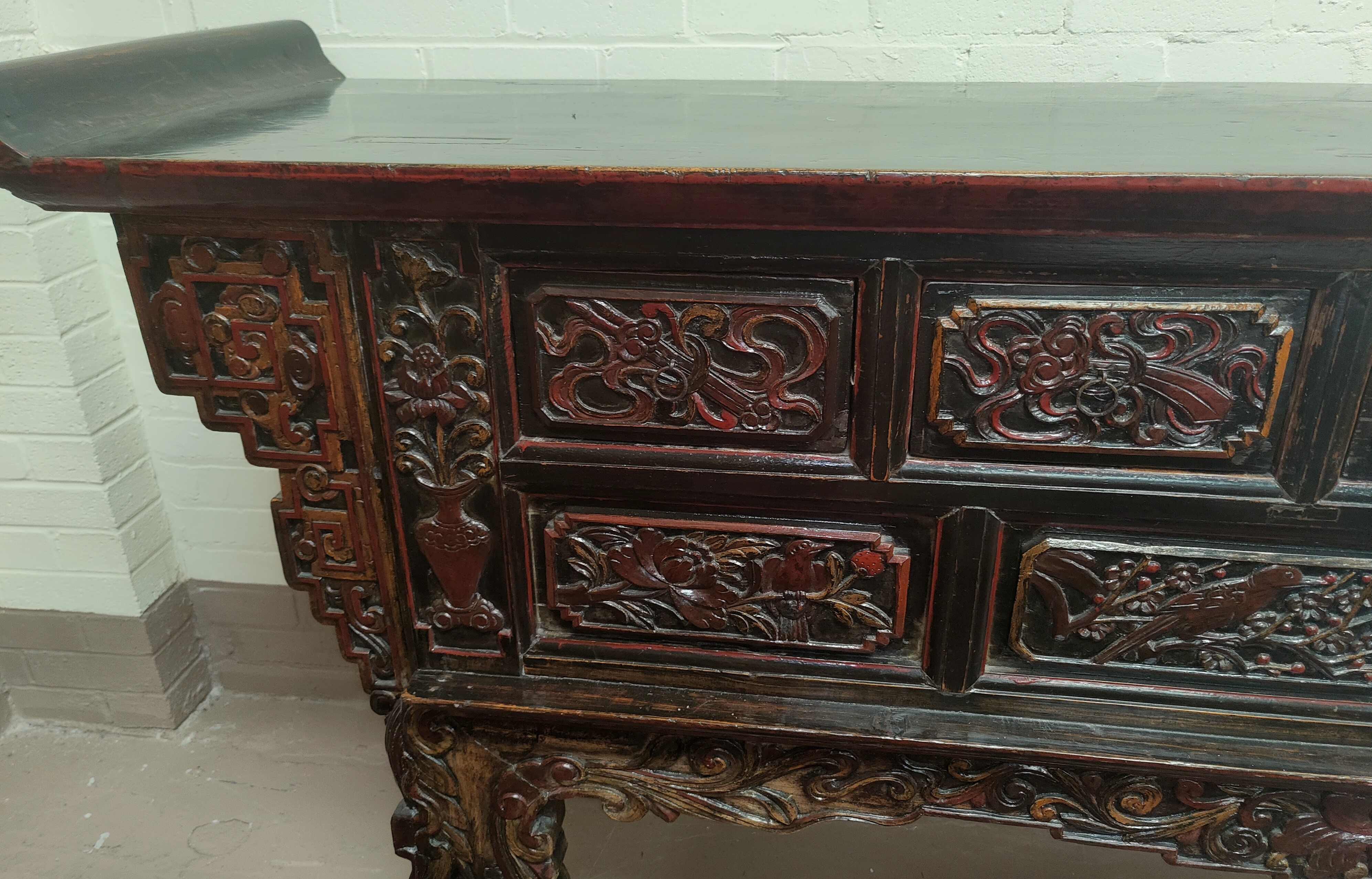 A late 19th/early 20th century Chinese unusual altar table, carved and lacquered with scroll end - Image 2 of 9
