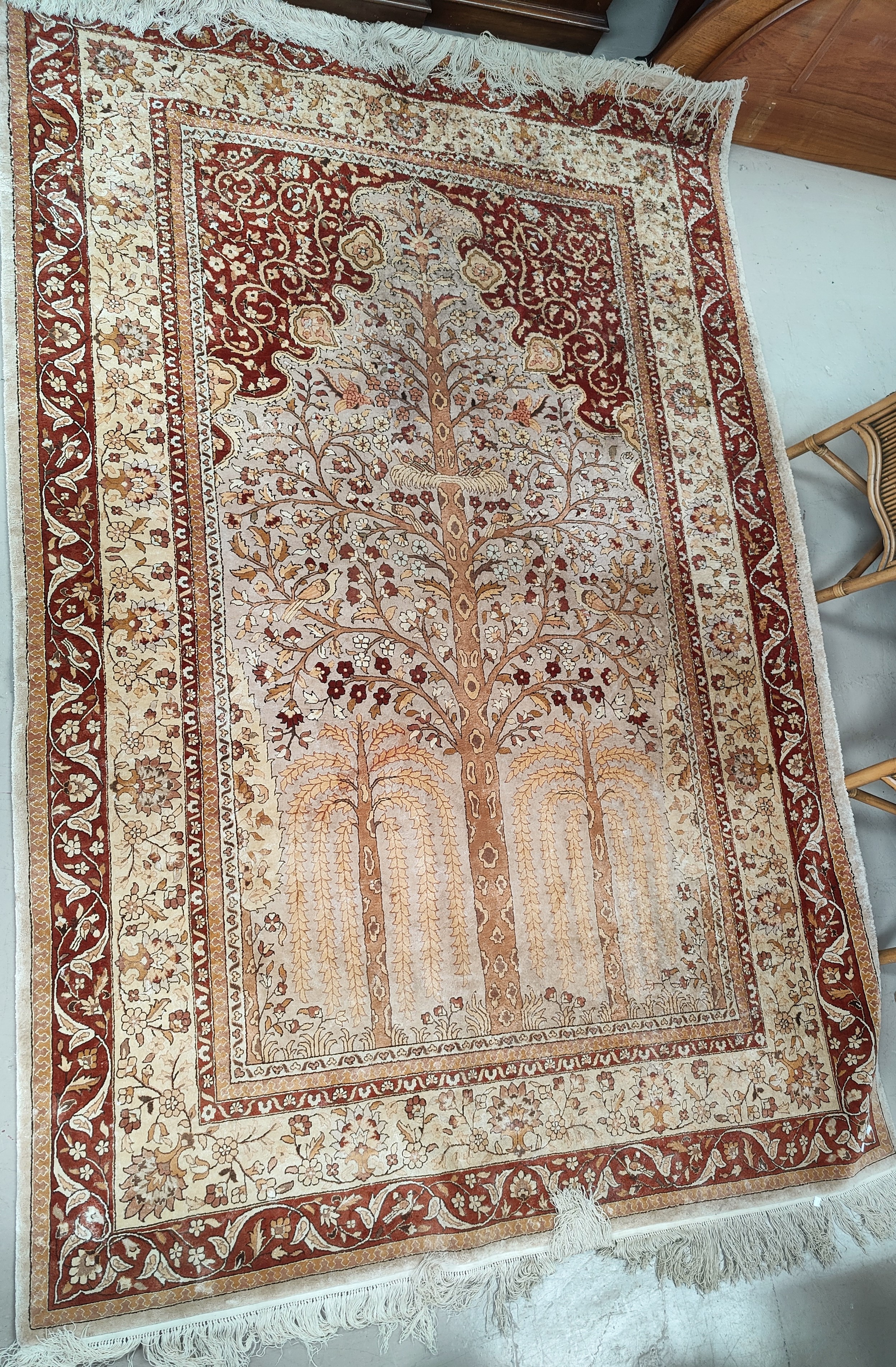 A mid 20th century Chinese silk carpet with Tree of Life pattern in the Persian manner, 6' x 9'