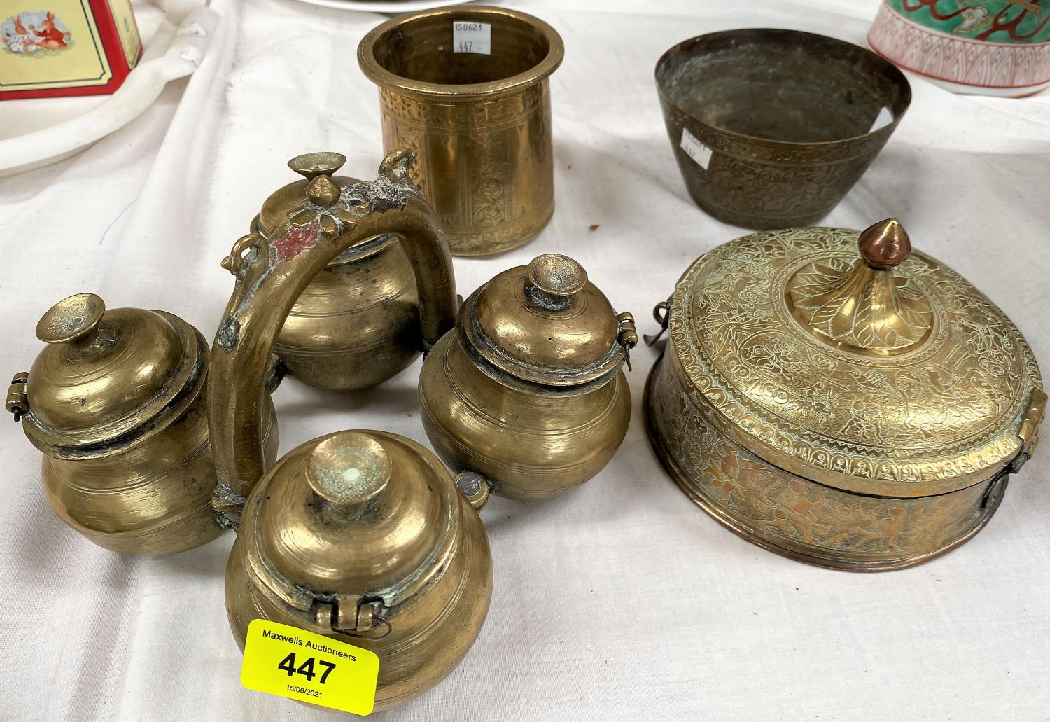 A Indian brass 4 section spice holder; a brass and copper Indian betel container and 2 Indian