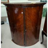 A mid Georgian figured mahogany corner cupboard with bow front and plain moulded cornice, 75 x 93