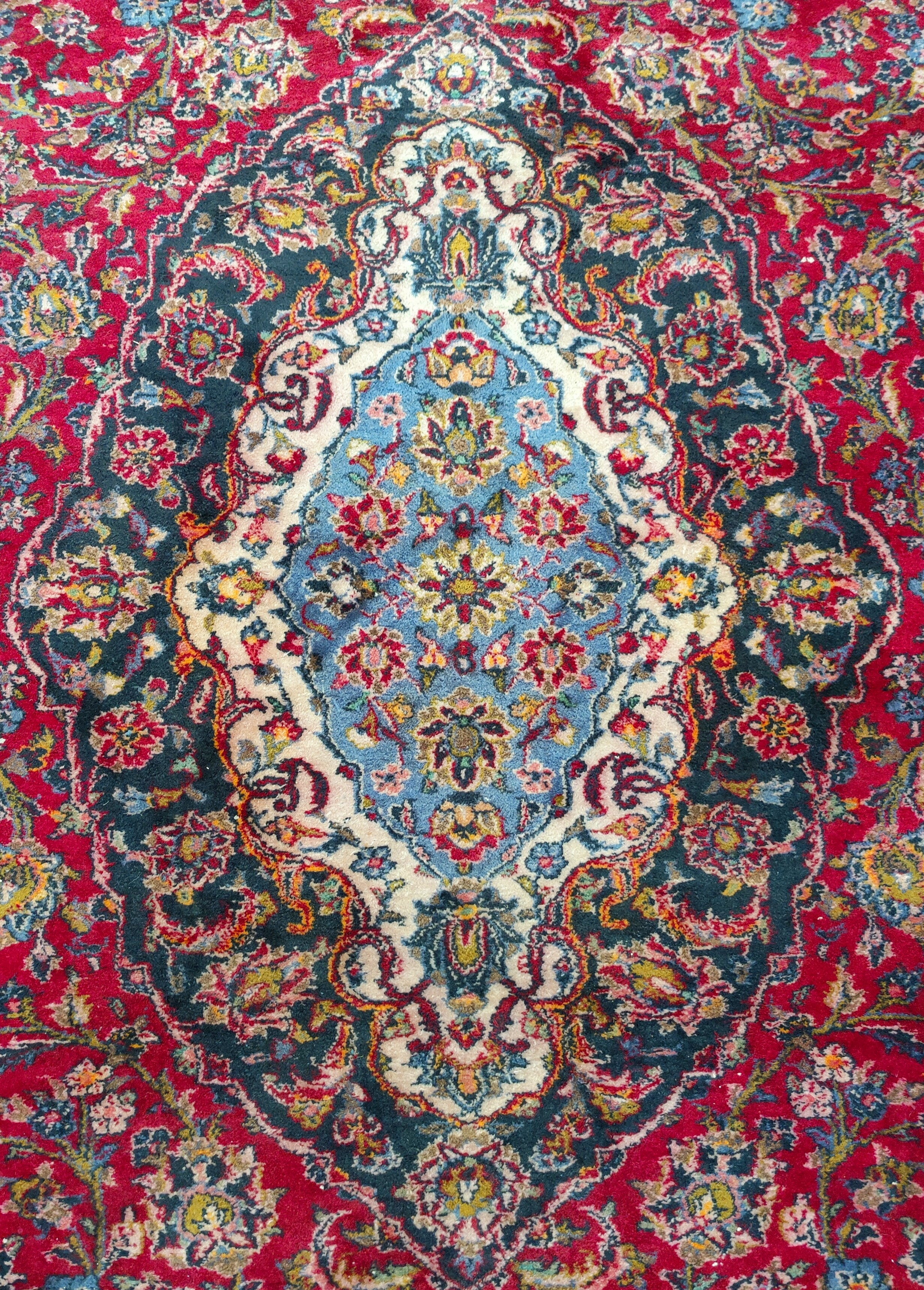 A mid 20th century Turkoman carpet, floral motifs on red ground multi-coloured, 9.5' x 12.5' approx - Image 3 of 4