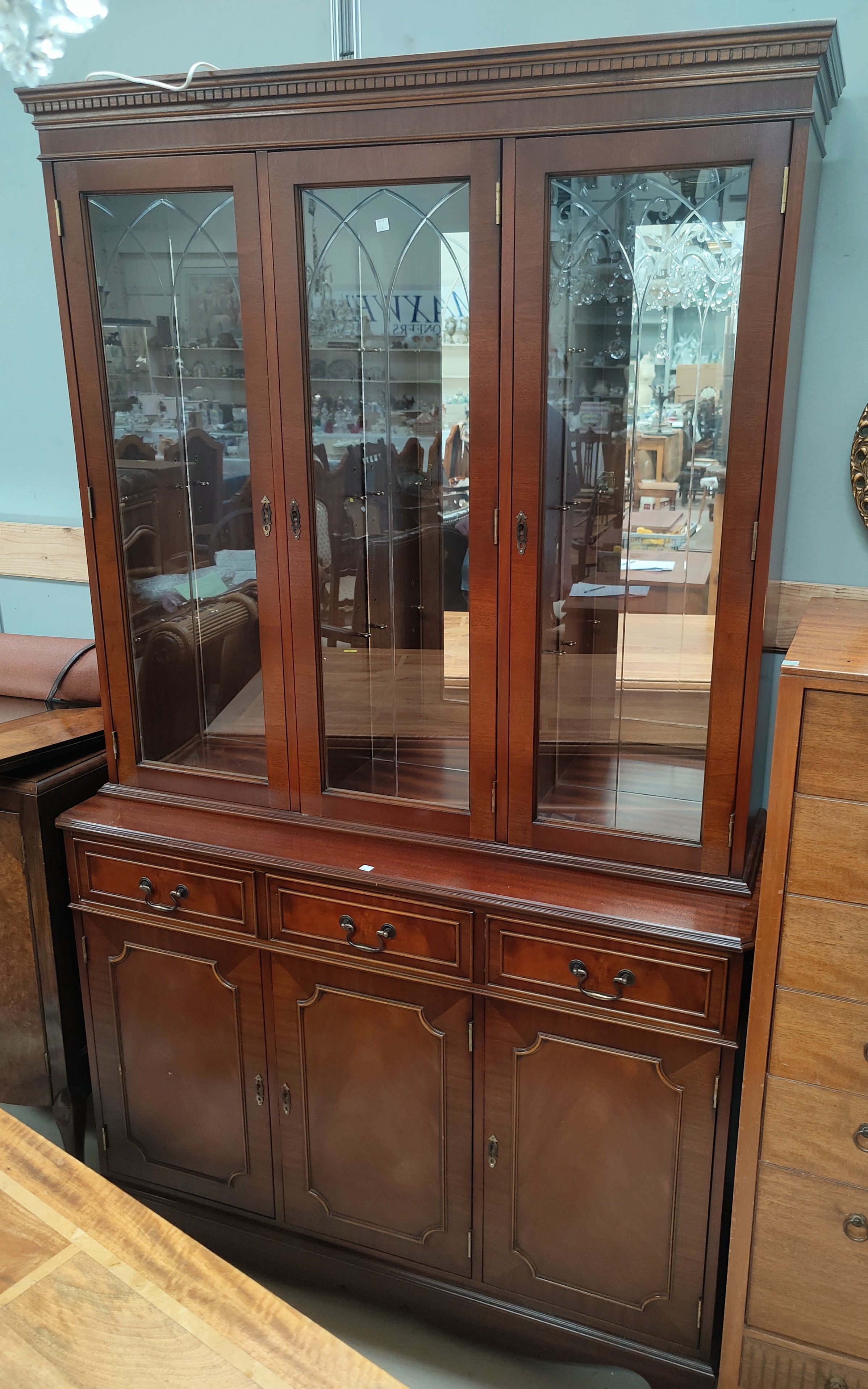 A reproduction mahogany wall unit with 3 glazed doors over 3 drawers & 3 cupboards