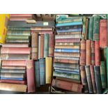 A selection of early 20th century books with decorative linen covers
