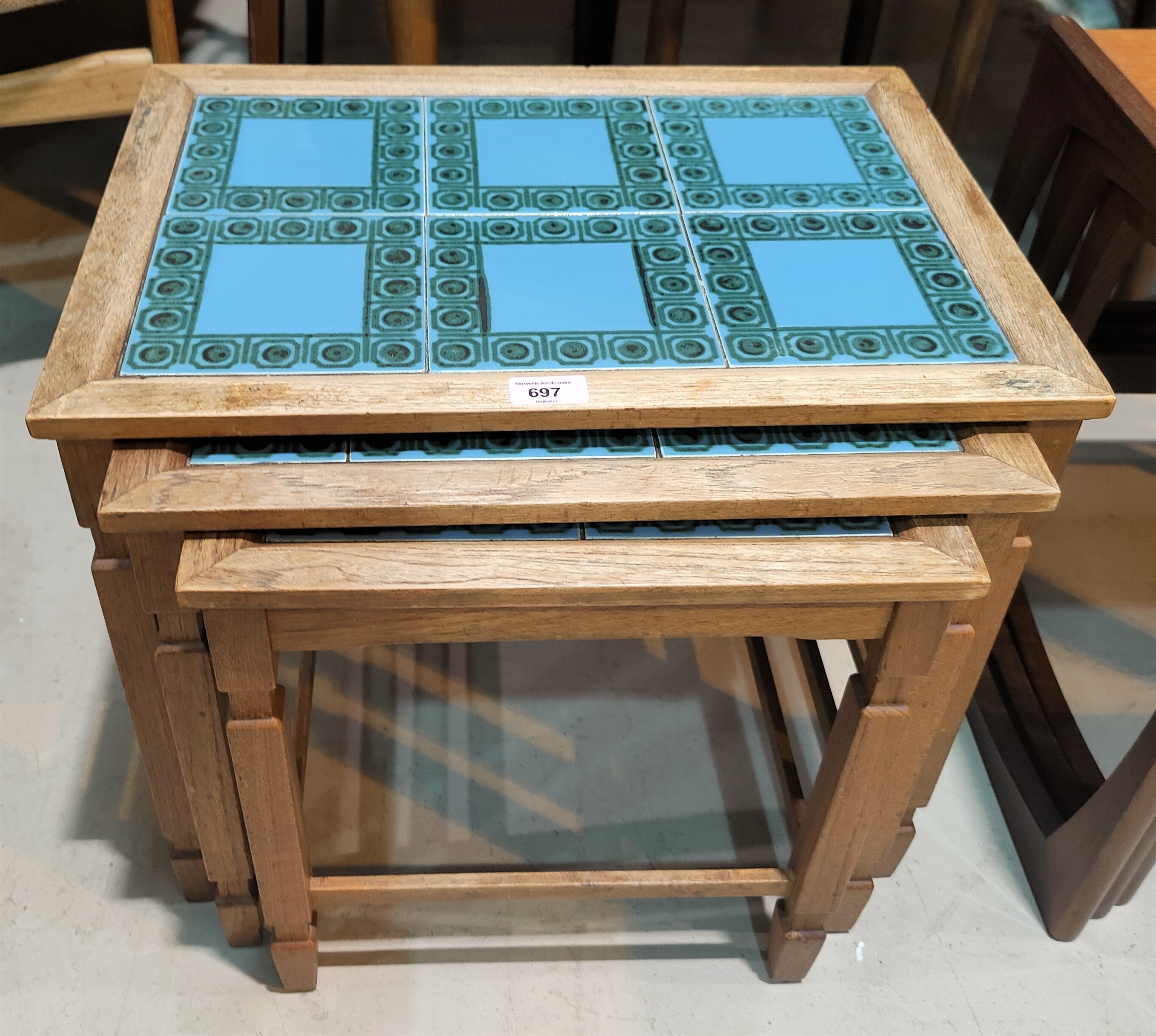 A 1970's set of 3 occasional tables with tile tops; a rustic style bench; a lightwood bar stool