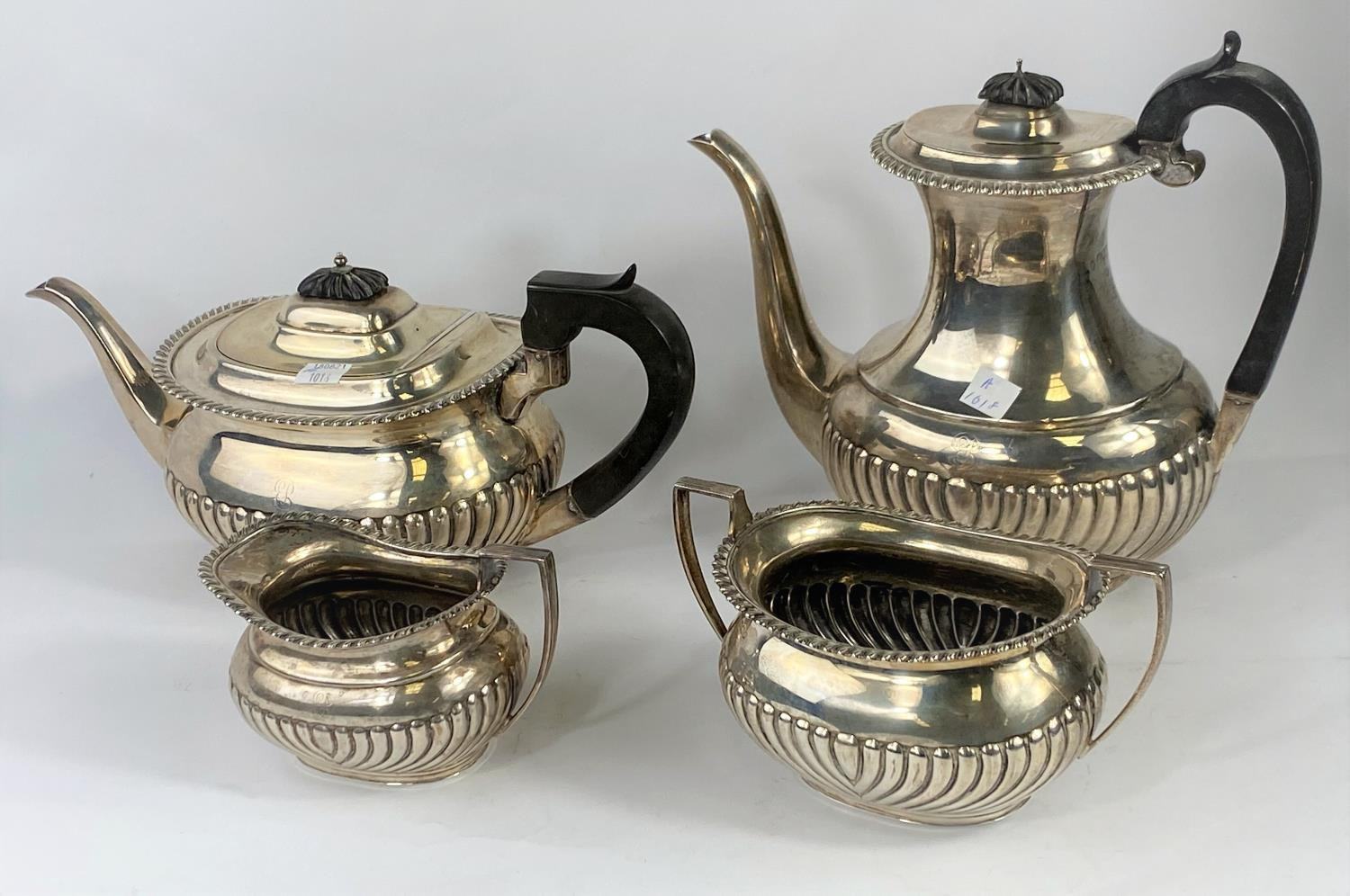 A hallmarked silver 4 piece tea set in the Georgian rounded rectangular style, with gadrooned and