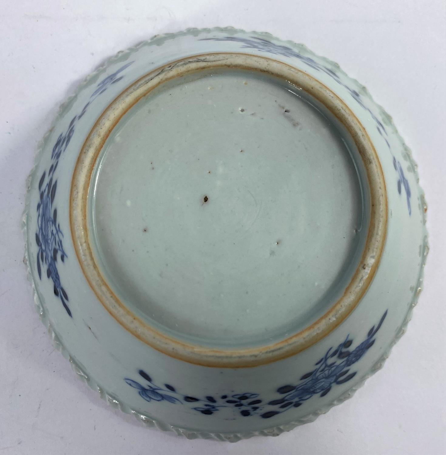 An 18th century Chinese blue and white porcelain bowl with pie crust rim decorated with antiques and - Image 3 of 5