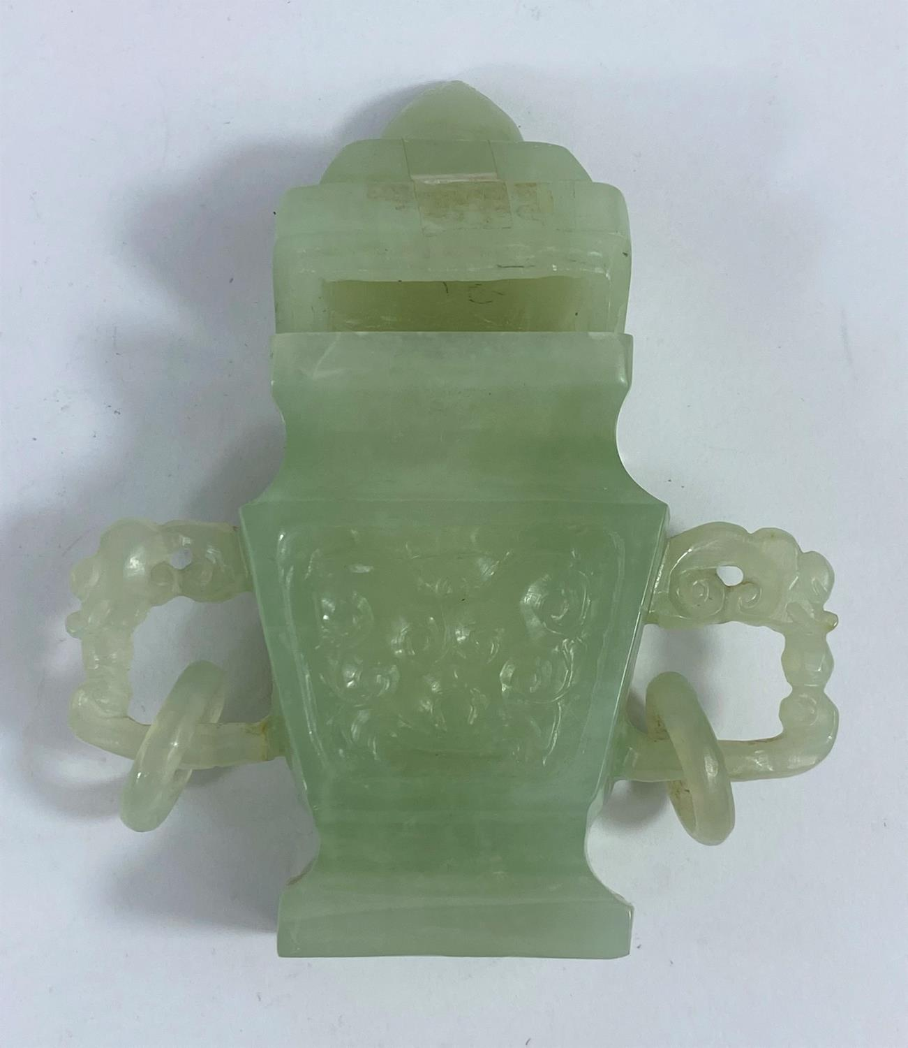A modern Chinese jade coloured covered vase with 2 handles, ht. 12cm