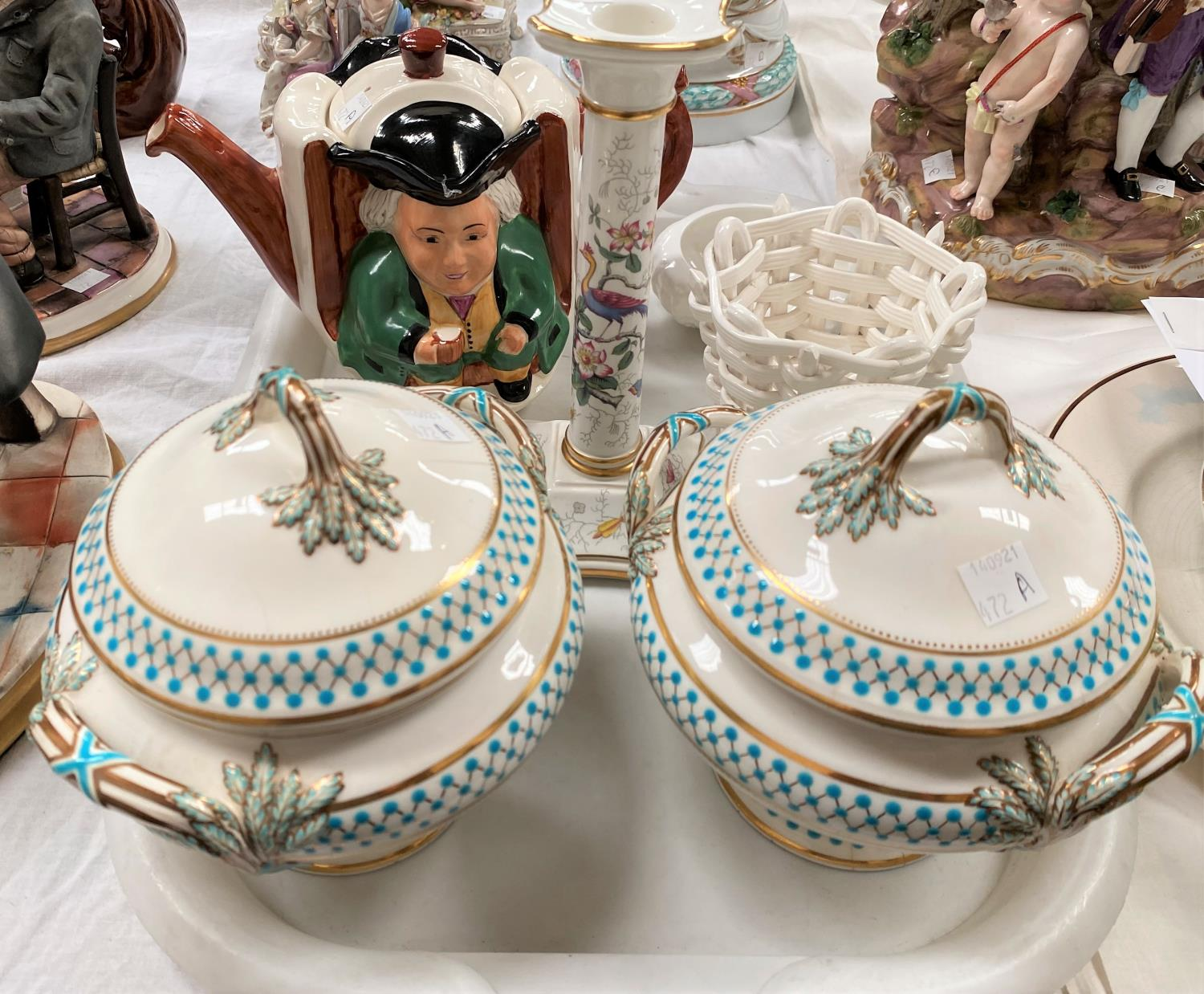 A pair of soup tureens decorated in gilt and turquise (some chips etc); a Coalport candlestick, a