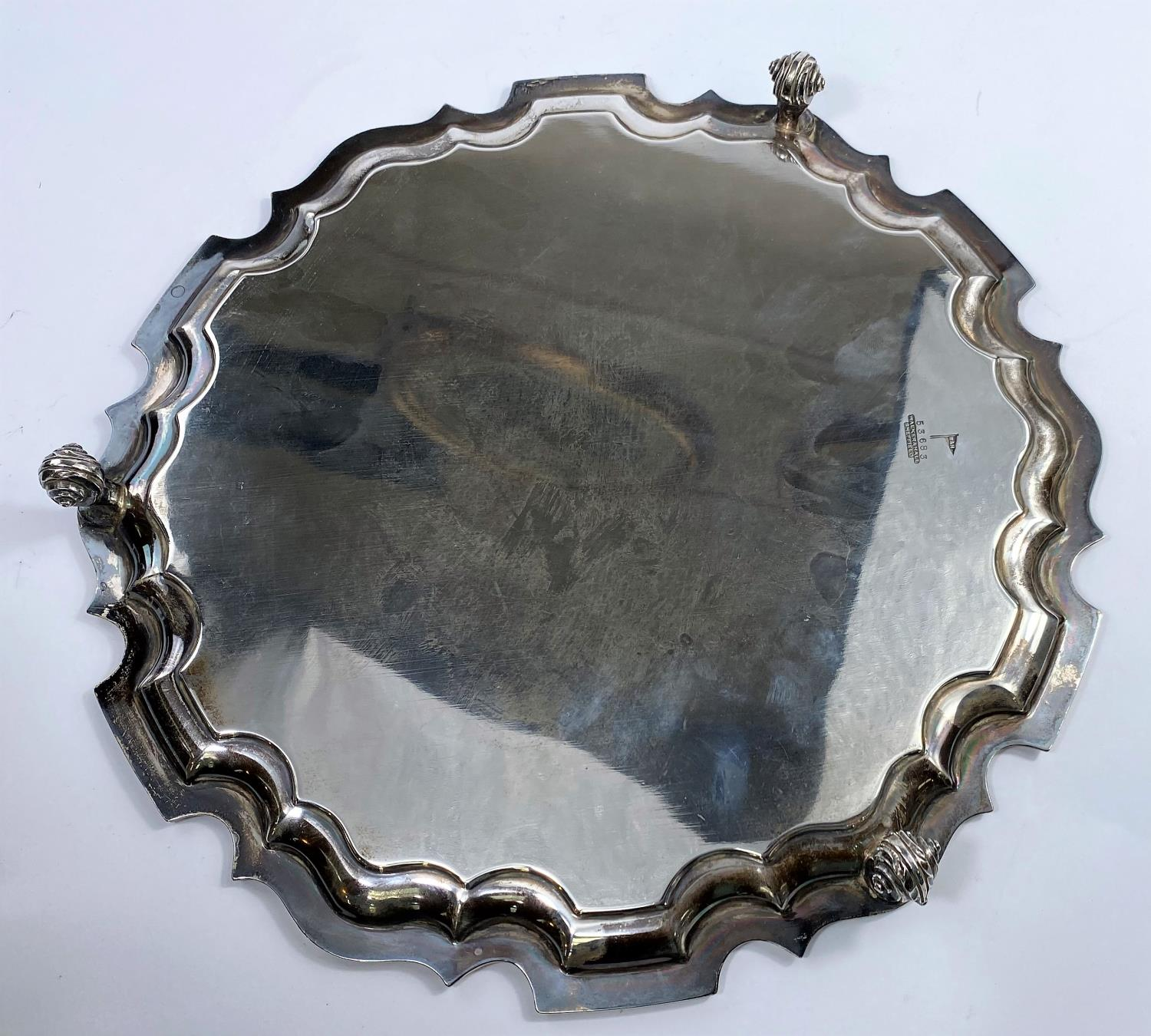 A hallmarked silver circular salver with scalloped edge, on 4 scroll feet, inscribed, Sheffield - Image 2 of 2