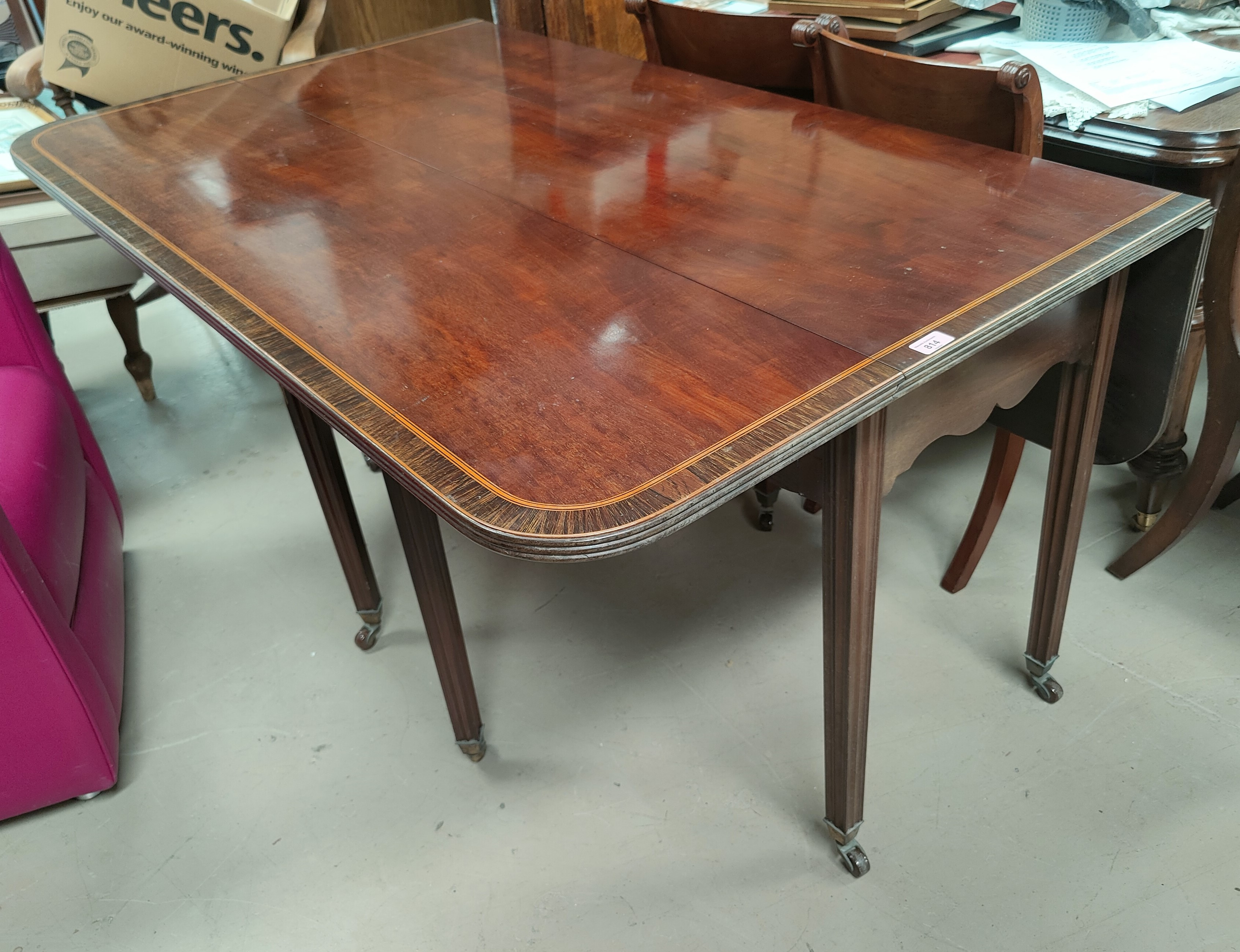 An early 19th Century spider leg dining table, plum pudding mahogany with coromandel crossbanding, - Image 3 of 3