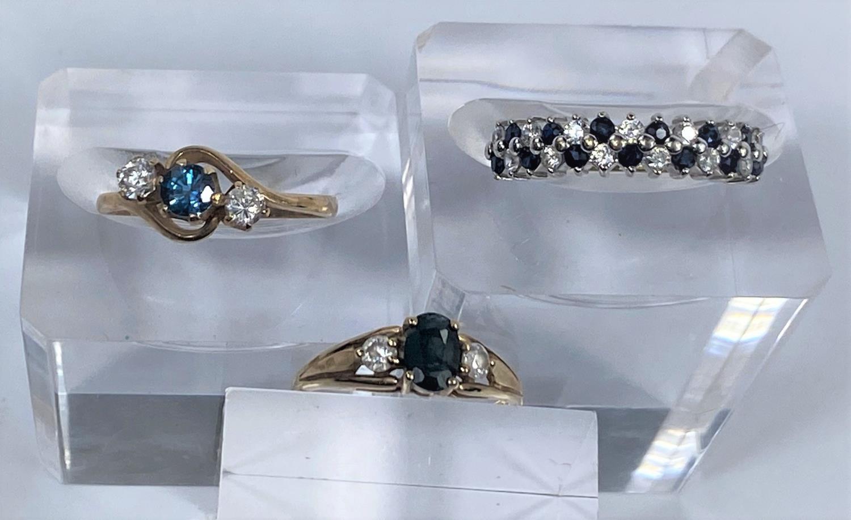 Three 9 carat hallmarked gold dress rings, 5.4 gm