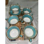 """A Wedgwood """"Ulander"""" turquoise and gilt soup set comprising of 6 double handled cups and 6 saucers"""