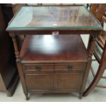 A reproduction mahogany occasional table with rectangular inset leather top; a mahogany