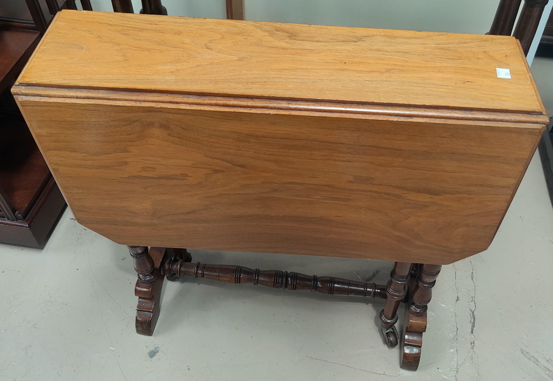 A Victorian mahogany revolving piano stool; an Edwardian walnut Sutherland table - Image 2 of 2
