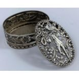 A hallmarked silver oval trinket box ornately pierced and embossed, London 1897, length 7 cm