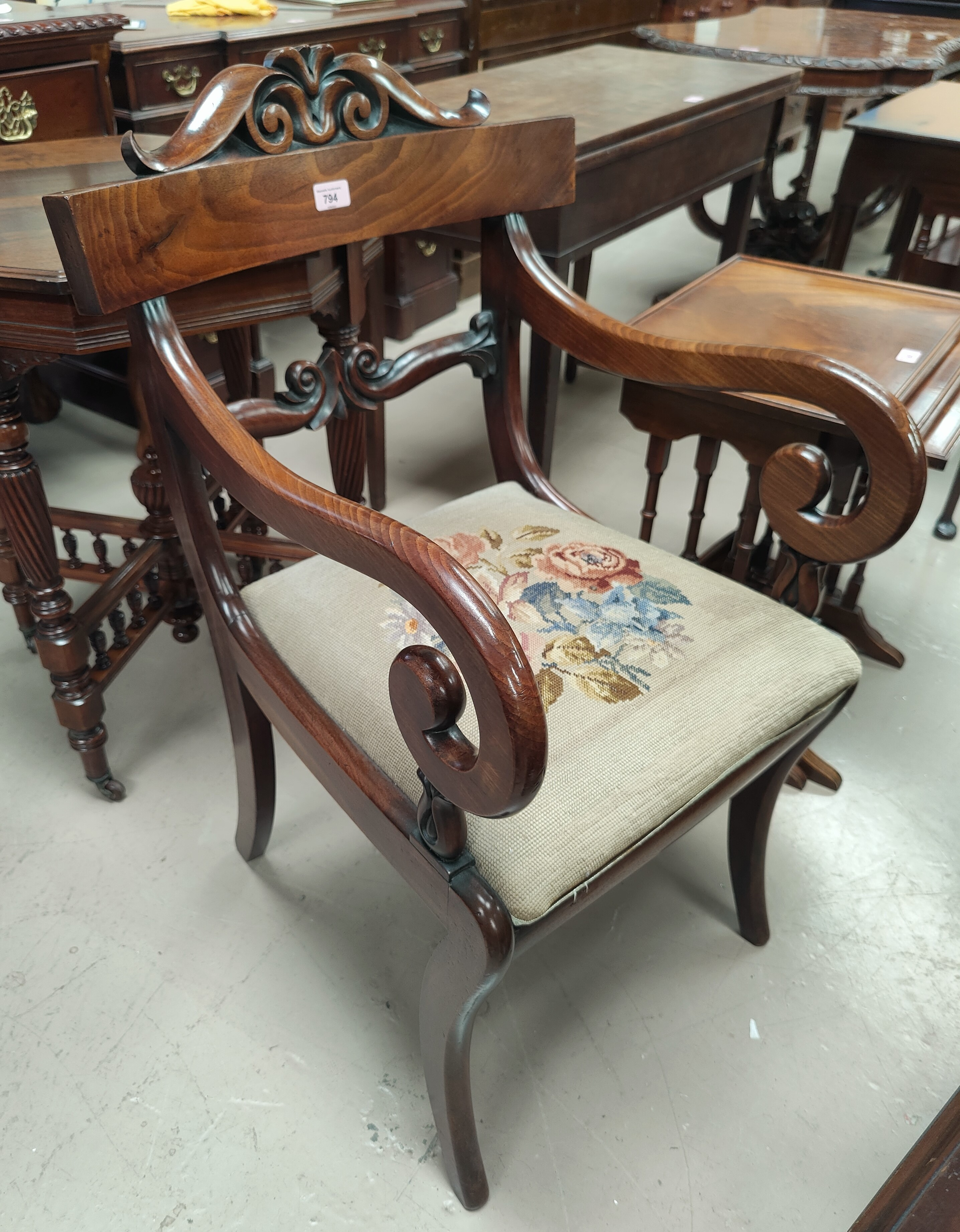 An Edwardian pair of inlaid mahogany armchairs with embossed green seats; a William IV mahogany