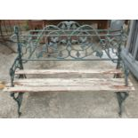 A Victorian style cast metal garden bench (one lath missing)