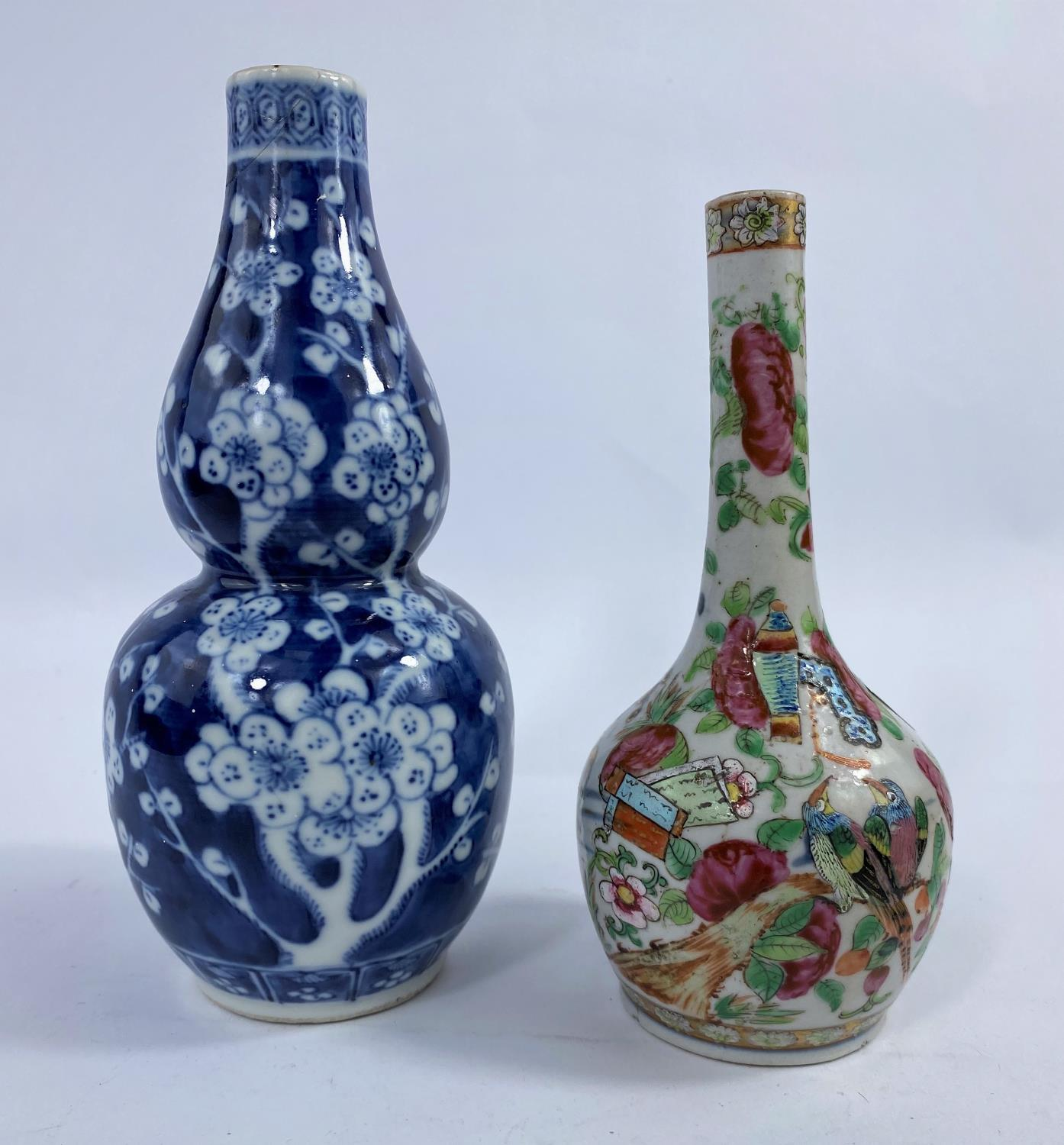 A 19th century Chinese blue and white double gourd vase, prunus blossom decoration, h. 19cm (rim a.