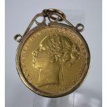 A Victorian sovereign 1876, in 9 carat hallmarked gold clip mount, 9.7 gm gross