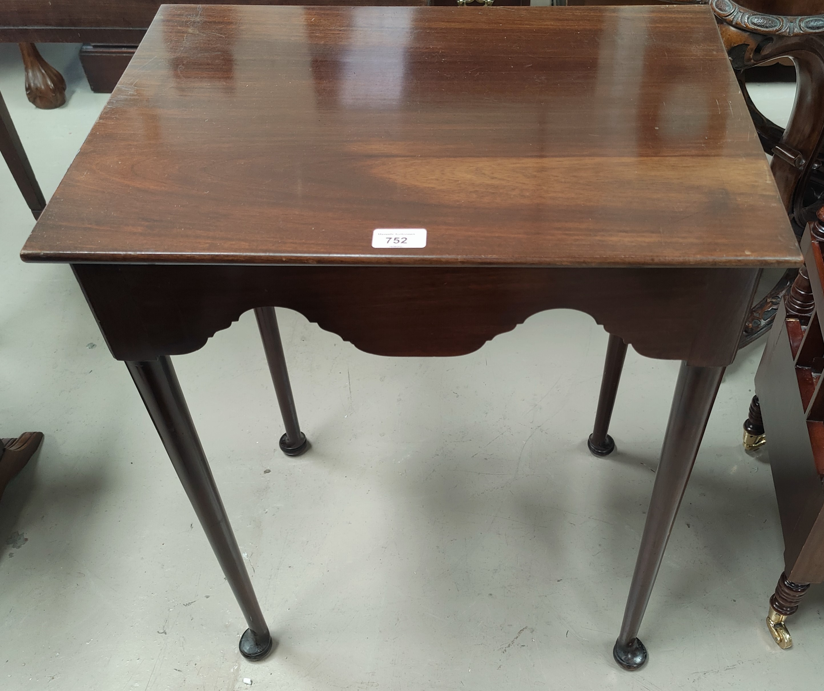 A Georgian style mahogany side table on pad feet, rectangular top with shaped under frieze, 55 cm