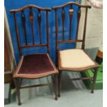 An Edwardian pair of Art Nouveau salon chairs with inlaid motif; an Arts & Crafts ladderback chair