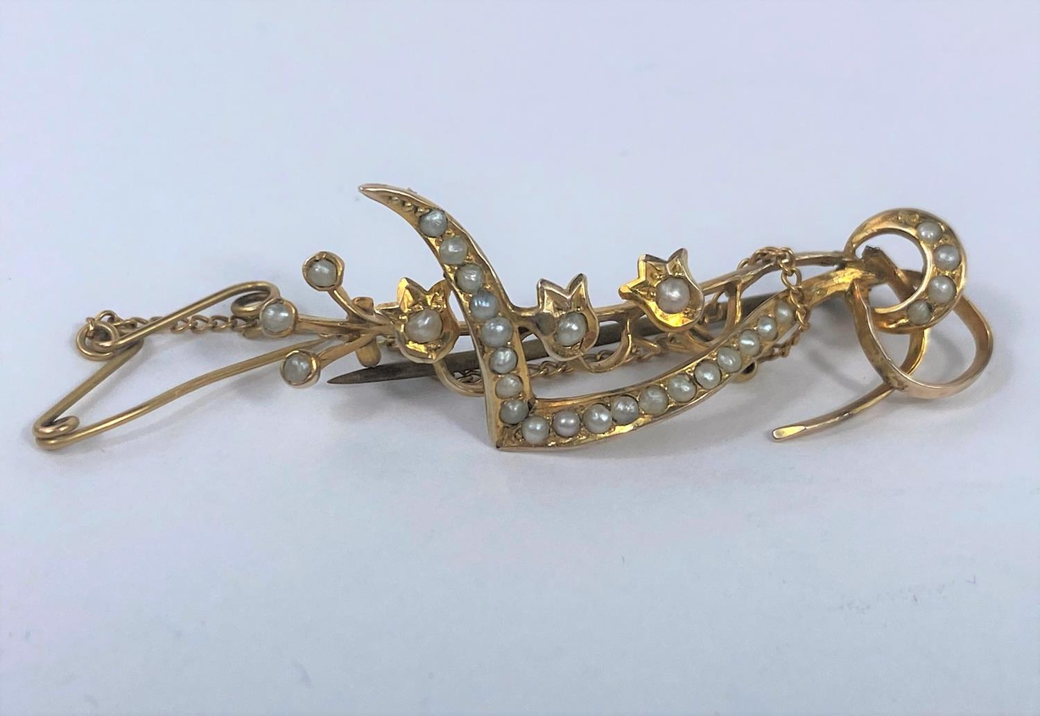 An ornate bar brooch set seed pearls, stamped '9ct'; a yellow metal bar brooch set seed pearl and - Image 2 of 3