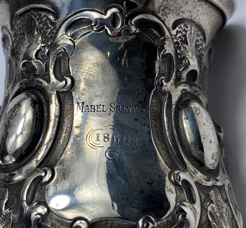 A hallmarked silver Victorian half pint mug on scroll feet, ornate decoration, inscribed, London - Image 4 of 5