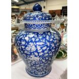 A very large 18th century blue and white lidded vase with prunus decoration, ht. 52cm (heavily