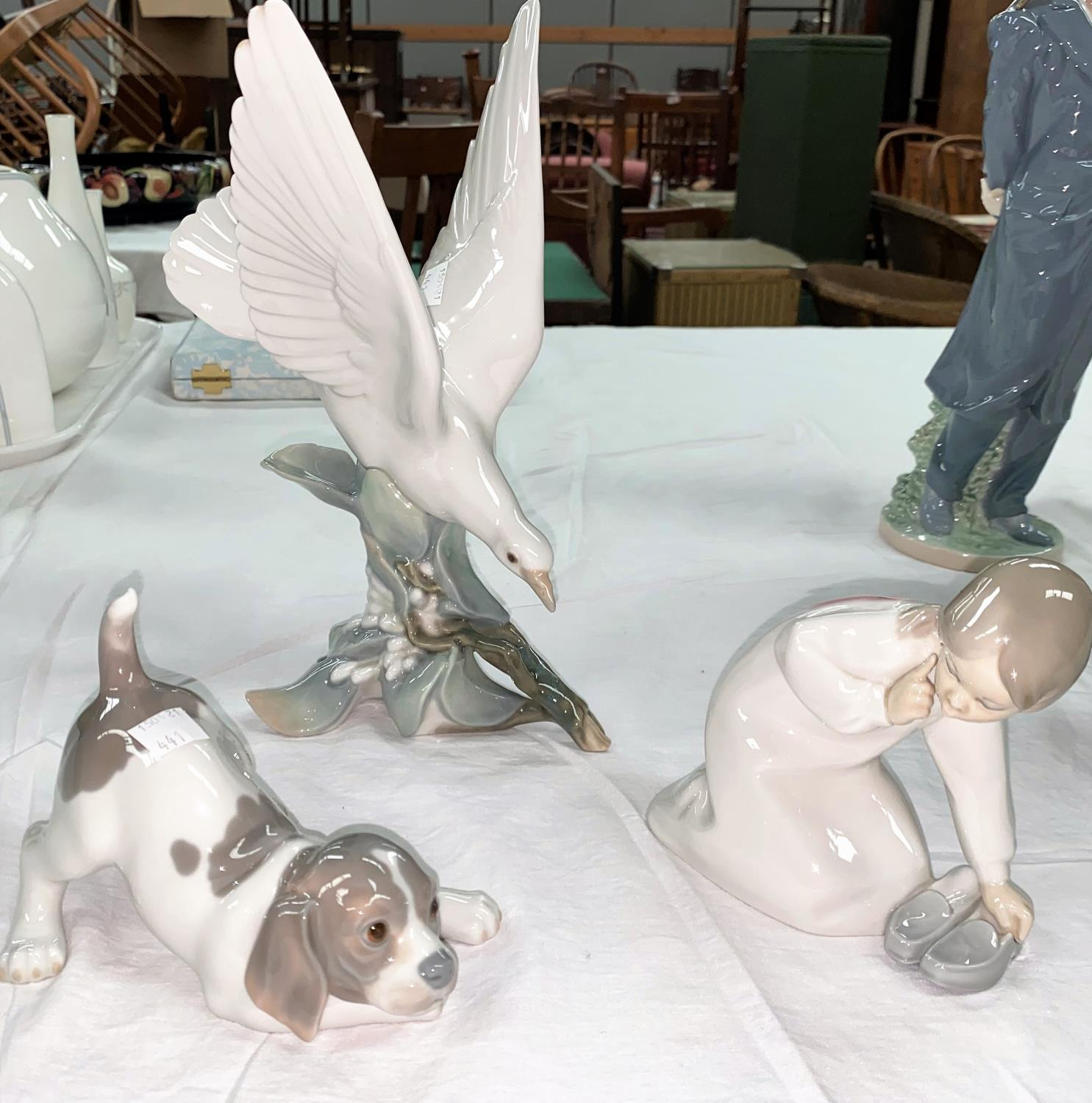 Three Lladro figures: dove; puppy & girl with slippers