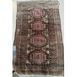 A mid 20th century Persian rug, hand knotted, with pink ground; 2 smaller Persian rugs