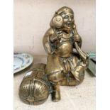 A Japanese polished bronze figure of a sage sitting on bales of hay, ht. 25cm